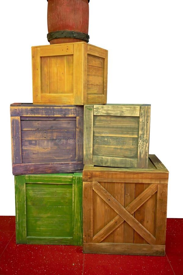 Красочным контейнеры и клети штабелированные шаржем деревянные стоковые изображения rf