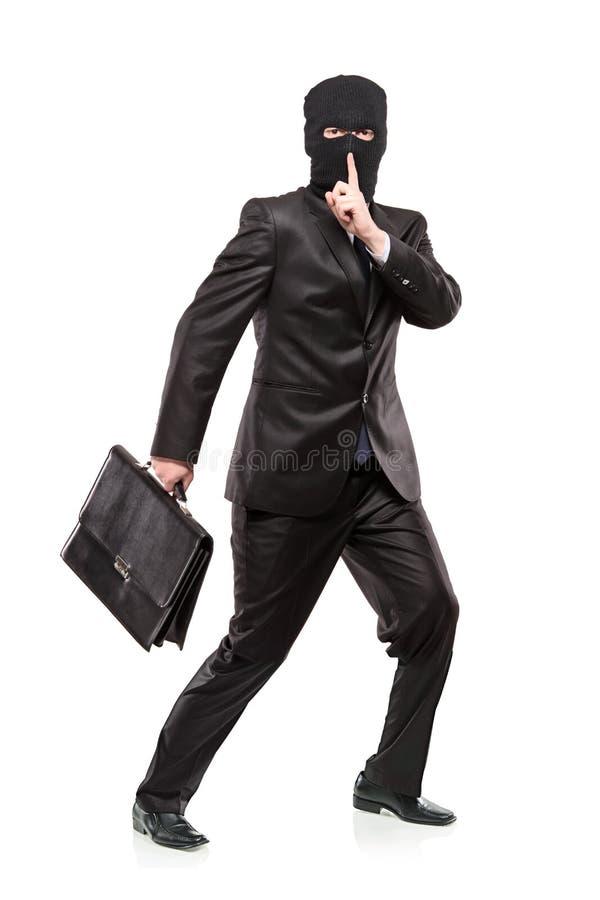 красть разбойничества маски человека портфеля стоковая фотография