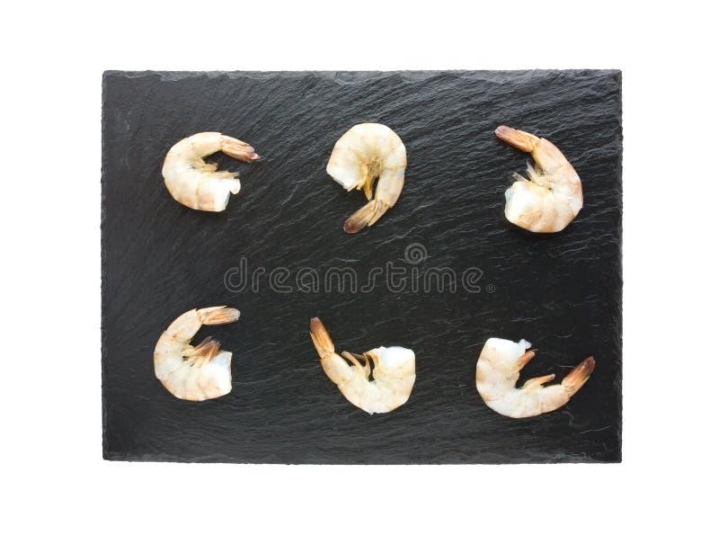 Креветки на шифере всходят на борт изолированный на белой предпосылке стоковые фотографии rf