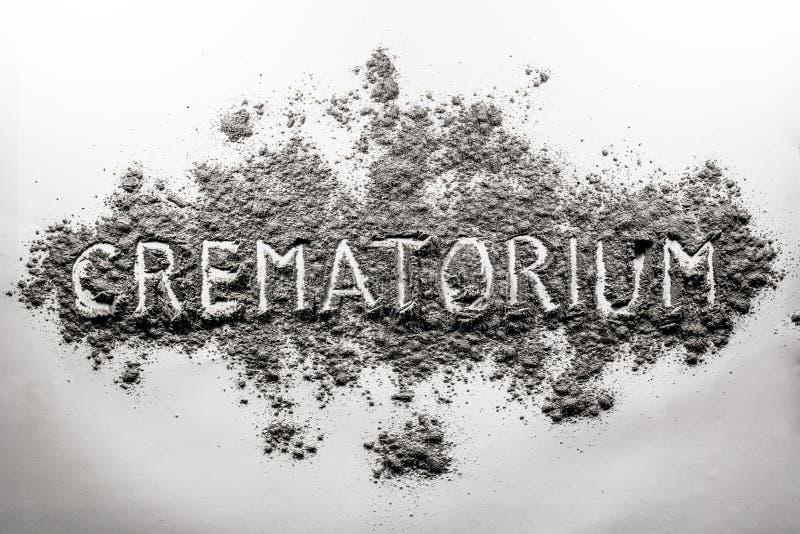Крематорий, слово крематорий написанное в золе, облаке пыли стоковые изображения