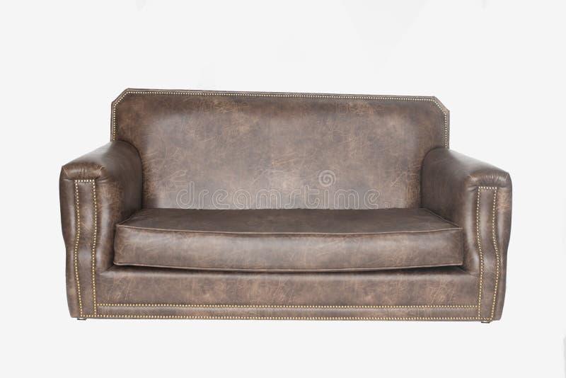 Кресло Брауна кожаное в интерьере просторной квартиры коричневая софа на белой предпосылке, стиль просторной квартиры o стоковая фотография