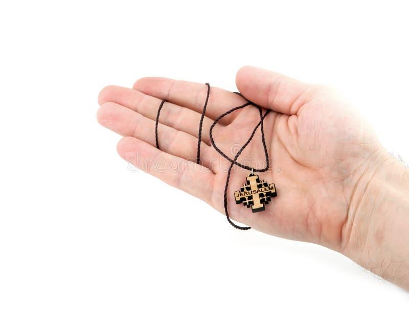 Крест в руке стоковое изображение rf