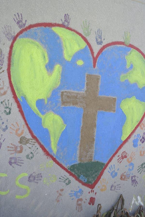 Крест на стене стоковая фотография