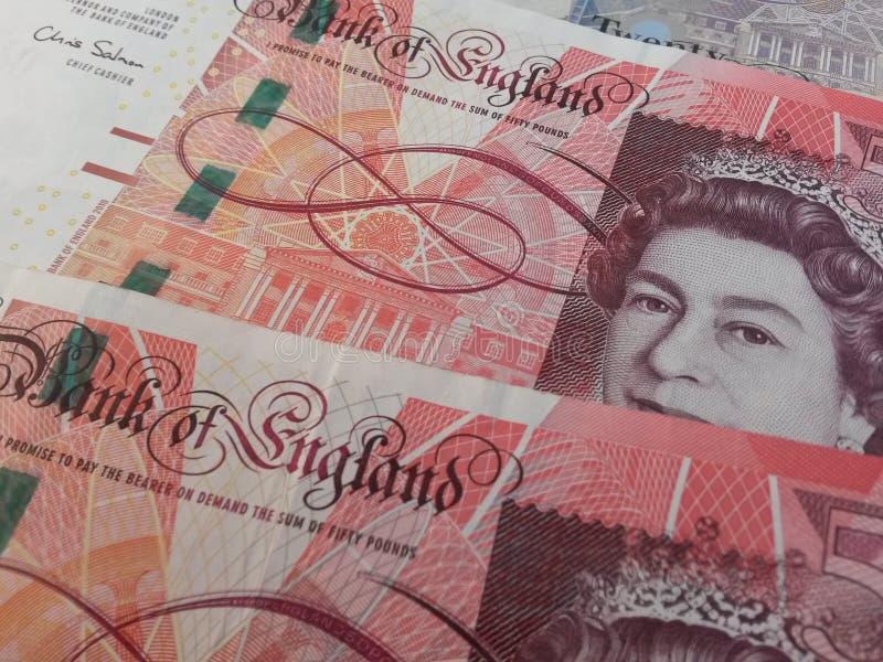 Кредитки и монетки GBP стоковое фото rf