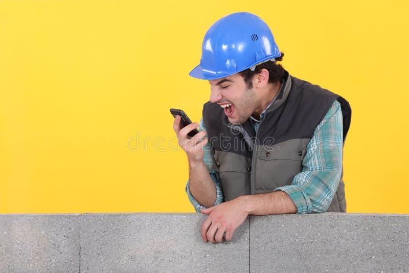 Кричать строителя стоковое фото rf