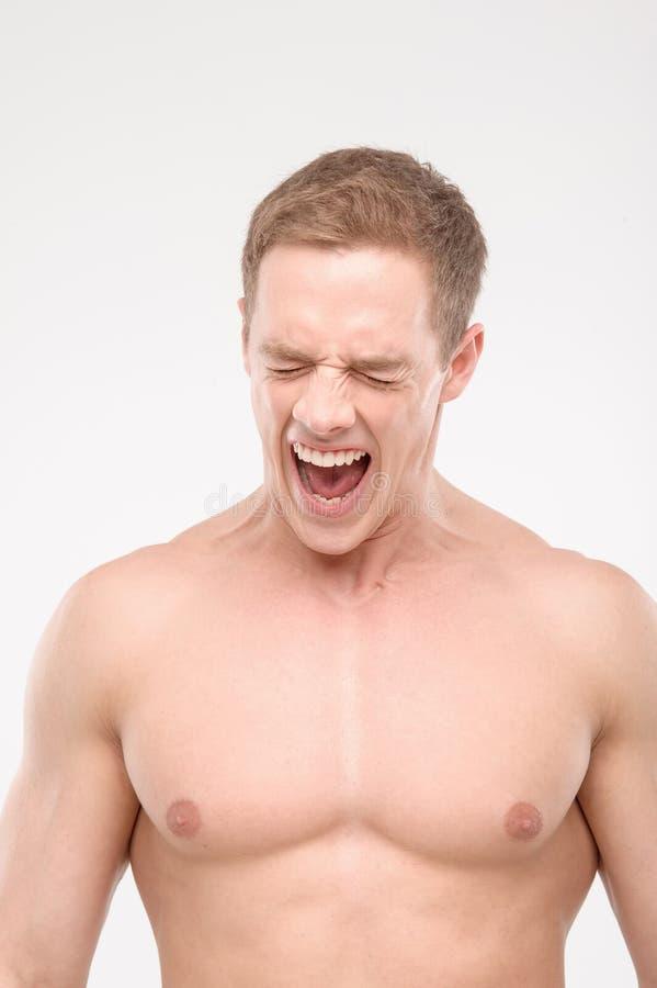 Кричащий спортсмен стоковые изображения