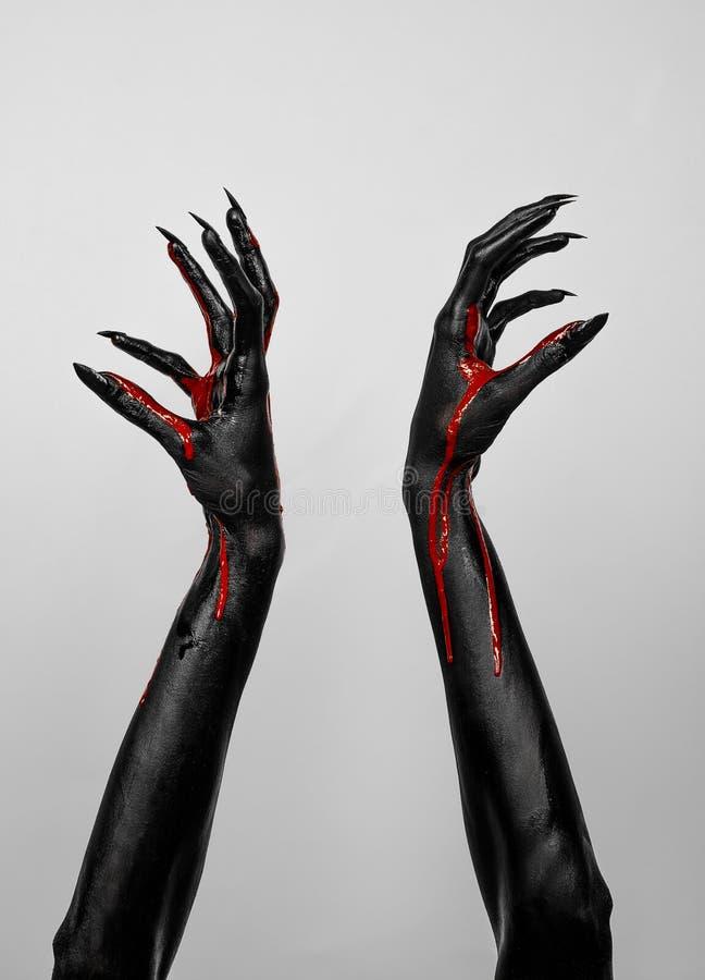 Кровопролитные черные тонкие руки смерти стоковое фото rf