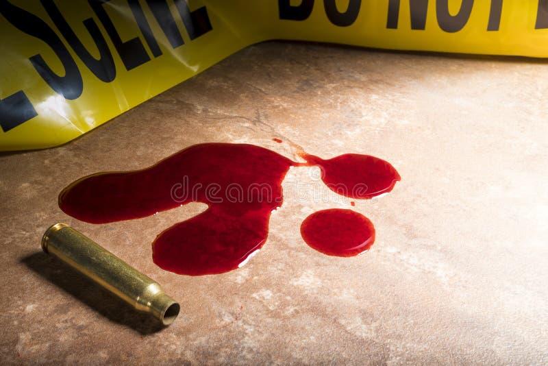 Кровь и латунь после злодеяния стоковые фото