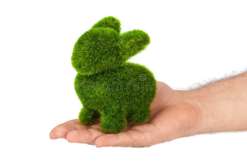 Кролик сделанный травы в руке стоковое изображение