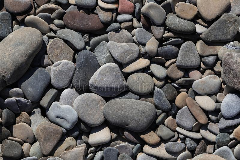 Круглая peeble предпосылка камней в конце вверх стоковое фото rf