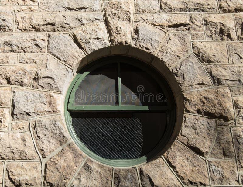Круглое окно в камне стоковые фото