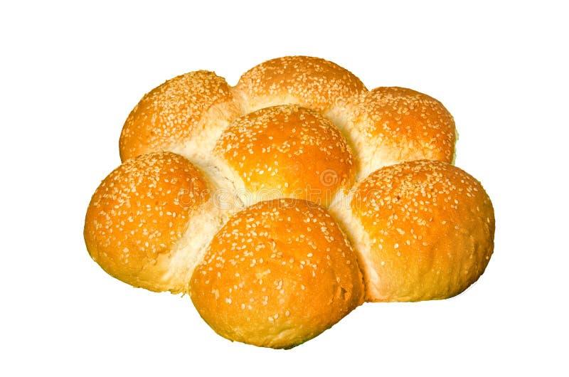 Круглый цветок сформировал хлеб изолированный на белизне стоковые фото