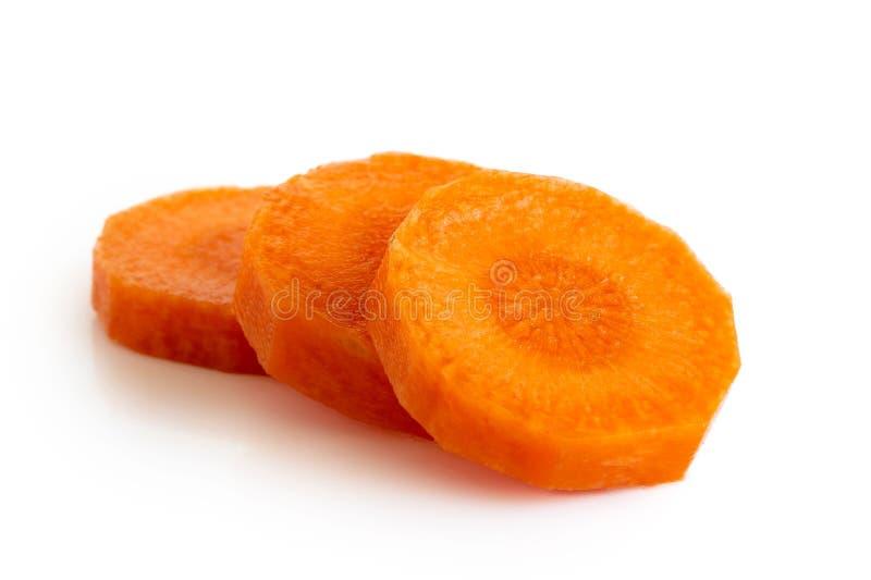 3 круглых куска, который слезли моркови изолированной на белизне стоковые фотографии rf