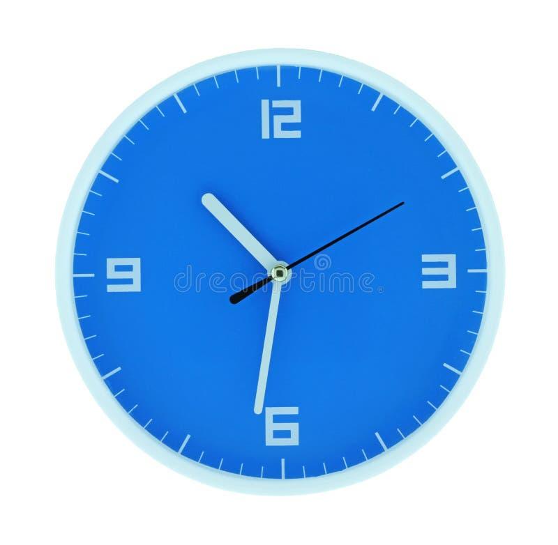 Круглые голубые часы стоковое фото