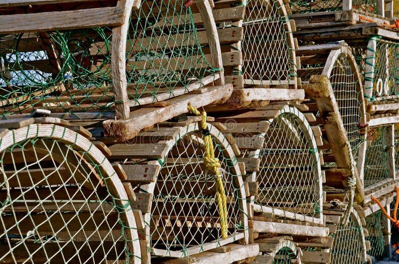 Круглые покрытые ловушки омара стоковые изображения
