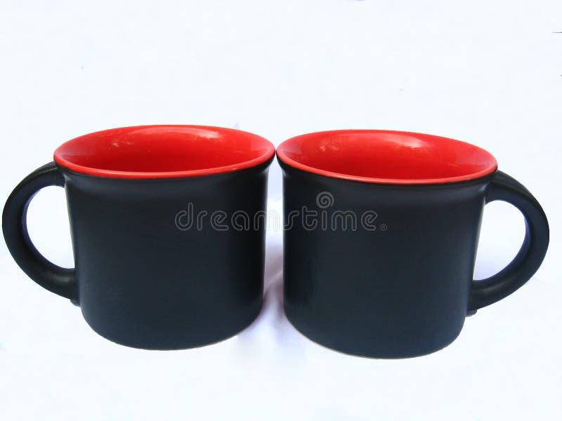 кружки черного кофе стоковое изображение