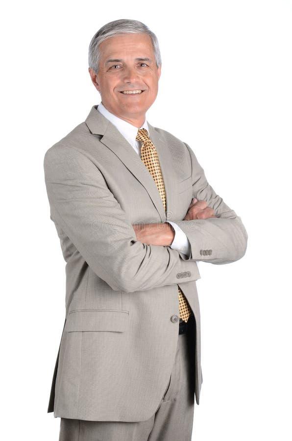 Крупный план зрелого бизнесмена случайно одел и держащ клетчатый прибор в его руке стоковое фото rf