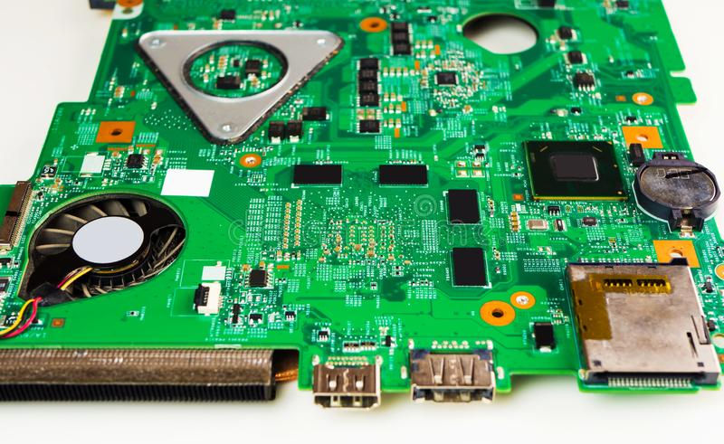 Крупный план снятый зеленой платы с печатным монтажом - PCB стоковое фото rf