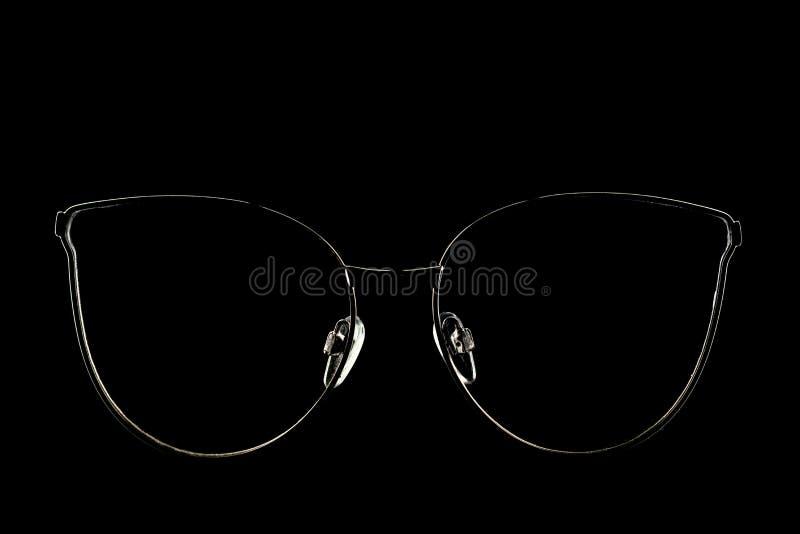 Крупный план современных элегантных солнечных очков светя в темноте стоковое изображение