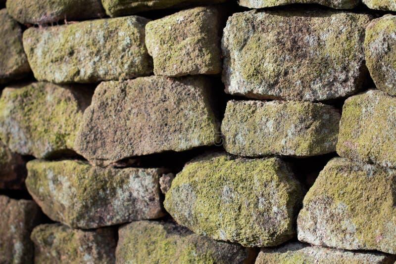 Крупный план текстуры предпосылки drystone стены стоковые фото