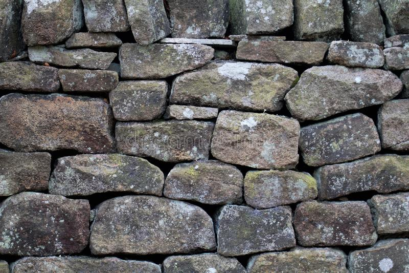 Крупный план текстуры предпосылки drystone стены стоковая фотография rf