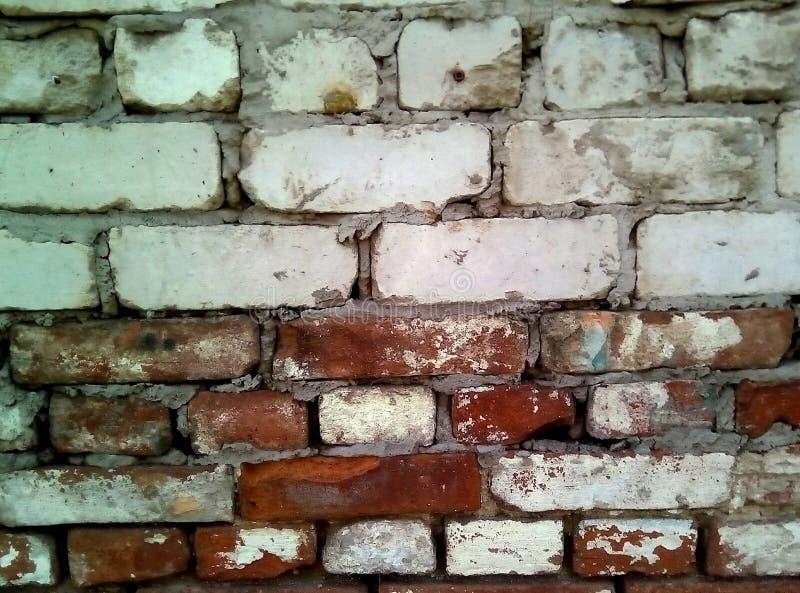 Крупный план части старой кирпичной стены Грубый masonry белого и красного кирпича стоковая фотография rf
