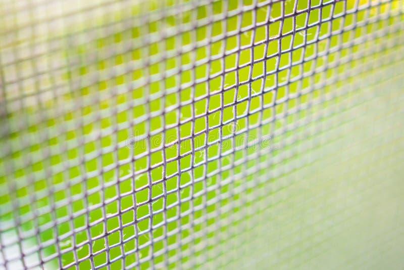 крупный план экрана провода сетки от комаров на предохранении от окна дома против насекомого стоковое изображение