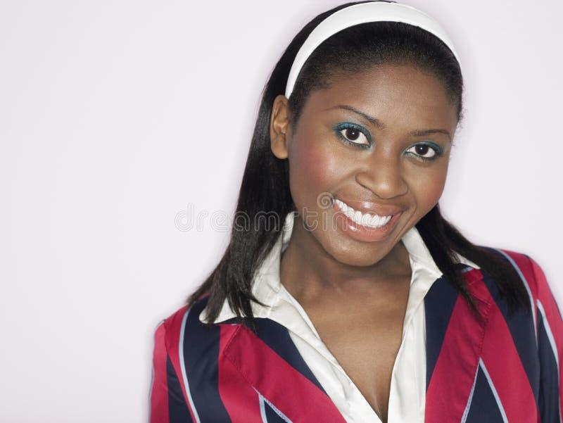 Крупный план Афро-американский усмехаться женщины стоковое фото