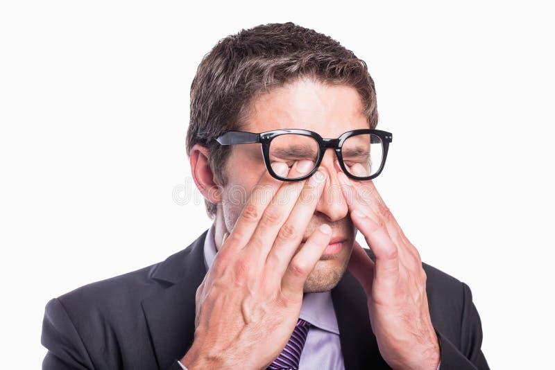 Крупный план глаз потревоженных затирания бизнесмена стоковое фото rf