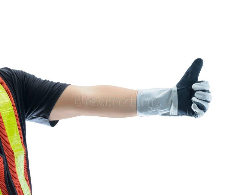 Крупный план мужской руки в защитных перчатках и показывать больших пальцах руки вверх стоковое фото rf