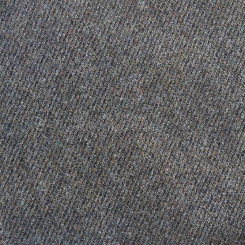 Крупный план ткани одежды из твида стоковые изображения rf