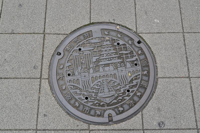 Крышка люка, Осака, Япония стоковое изображение