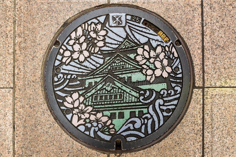 Крышка люка в Осака, Японии стоковое изображение rf
