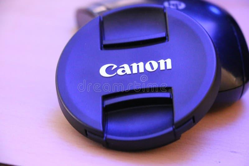 Крышки объектива канона для фотографии и видеозаписи стоковое фото