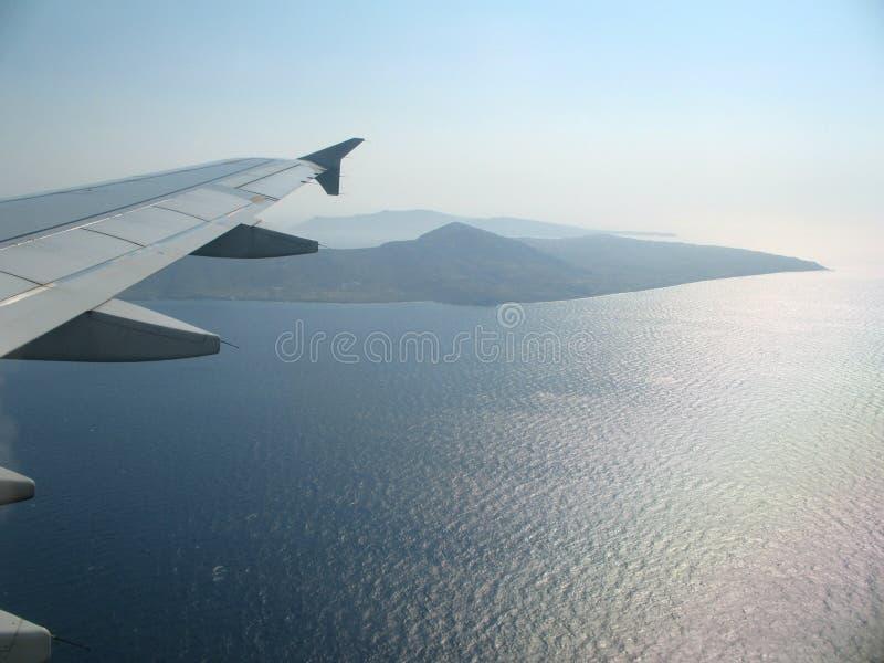 Крыло Airplan над морем стоковые фотографии rf