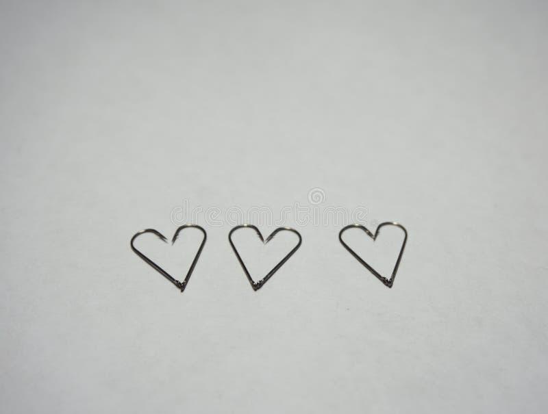 Крюки и параллельно черви сердца стоковое изображение