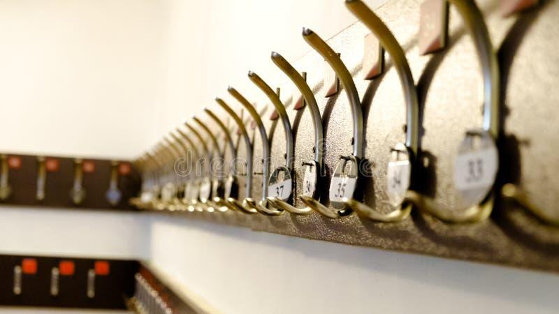 Крюки для одежд с номерами стоковое фото rf