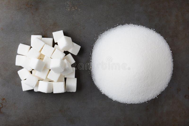 Кубы сахара и раздробленный стоковые изображения