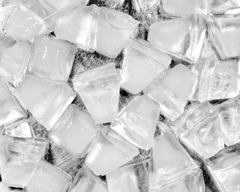 Куб льда на нержавеющей предпосылке стоковые фотографии rf