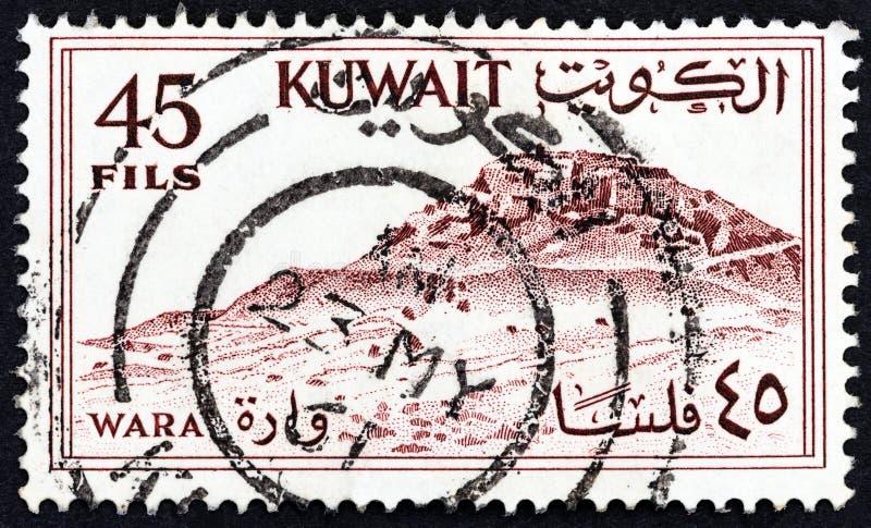 КУВЕЙТ - СИРКА 1961: На марке, напечатанной в Кувейте, изображен холм Вара, около 1961 года стоковое фото rf