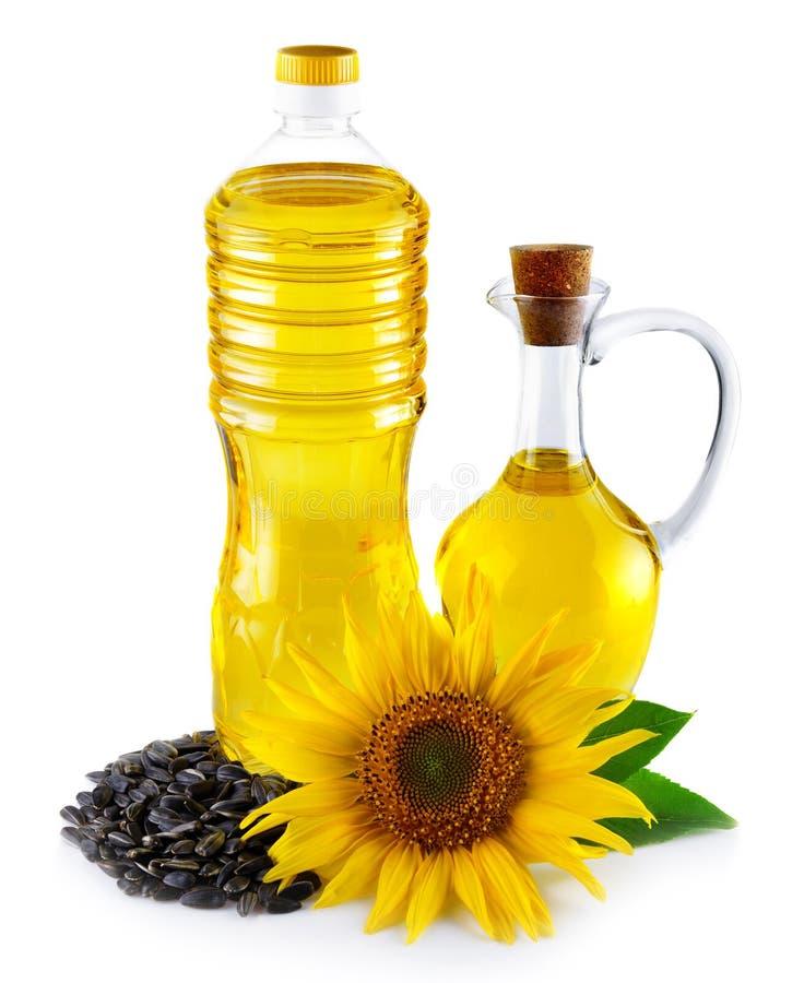 Кувшин и бутылка с подсолнечным маслом при изолированные семена стоковые фотографии rf