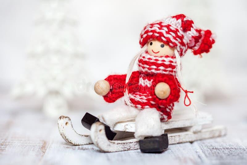 Кукла девушки рождества на санях для украшения стоковые фотографии rf