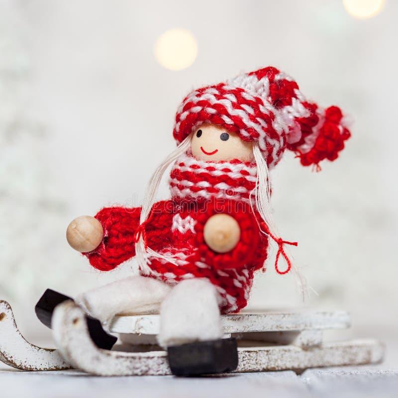 Кукла девушки рождества на санях для украшения стоковое фото