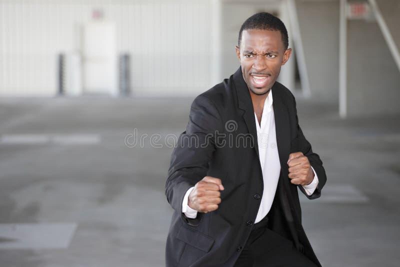 кулачки бизнесмена готовые стоковое изображение rf