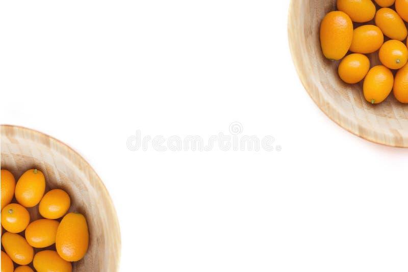Кумкваты или japonica цитруса cumquats изолированное на белой предпосылке стоковые фото