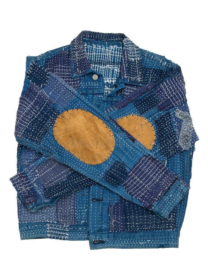 Куртка демикотона заплатки моды стоковое фото