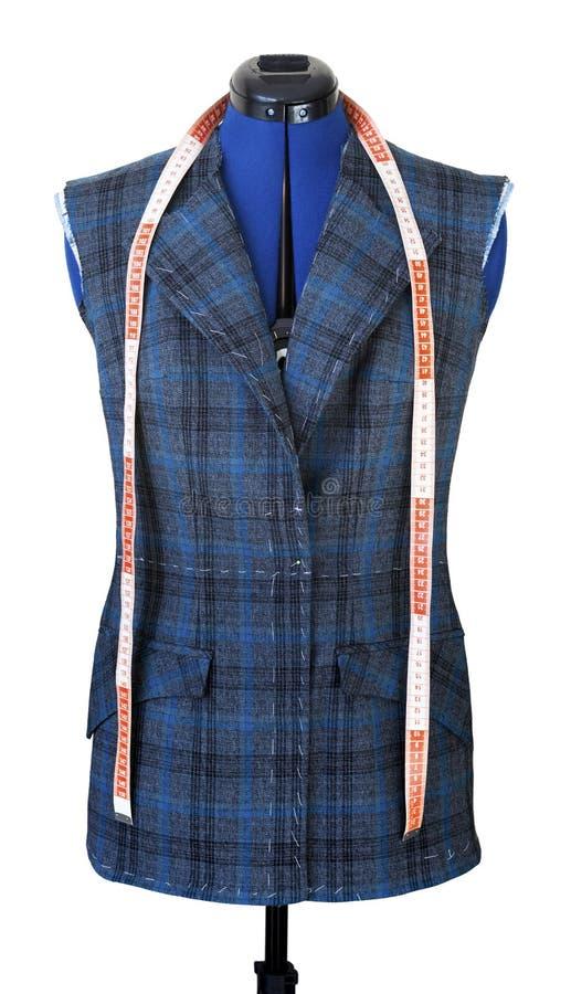 Куртка на манекене в процессе свой шить Приспособление модное не но готовая куртка на манекене стоковое фото rf