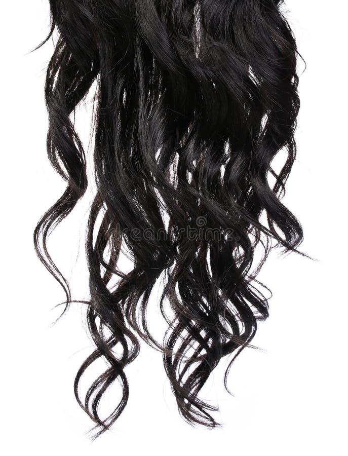 Курчавые черные волосы изолированные в белизне стоковое фото rf