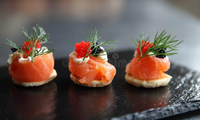 Курят salmon canapés стоковые изображения