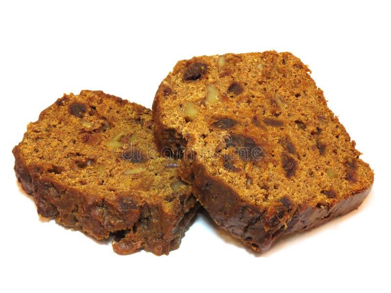 2 куска свеже испеченного торта хлебца чая, изолированного o стоковое фото